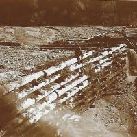 Debris dam built to contain sediments from hydraulic mining